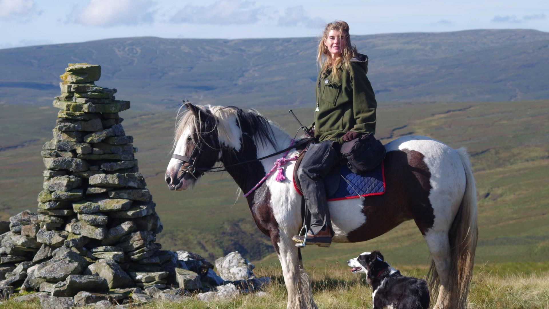 Amanda Owen on horseback with sheepdog